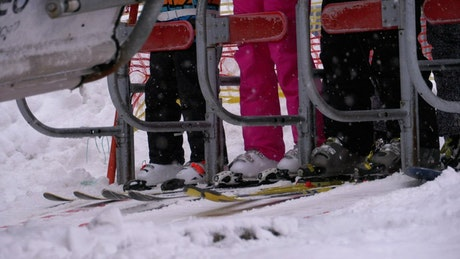The skiers getting ready to board the ski lift