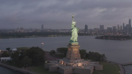 The Statue of Liberty during a cloudy night