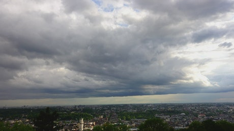 Thick clouds over a large city