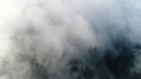 Thick clouds over a mountain