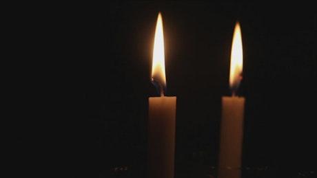 Thin candles burning