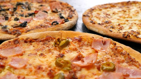Three different types of pizza