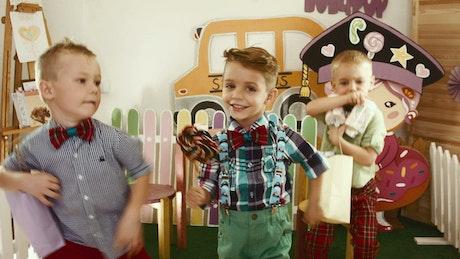 Three happy boys dancing
