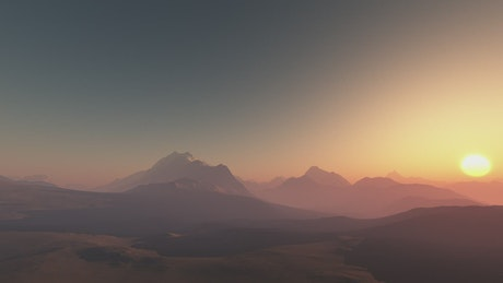 Through mountains illuminated by sunset light
