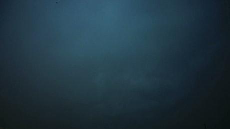Thunderstorm across the night sky