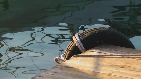 Tied rim on the edge of a pier, close up view