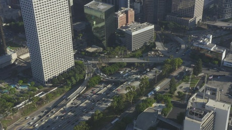 Tilt aerial shot of a city full of tall buildings