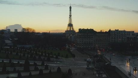 Tilt aerial shot of the Eiffel Tower at dawn