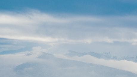 Tilt shot in a foggy winter mountains