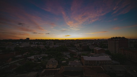 Time lapse of a sunrise in a city skyline