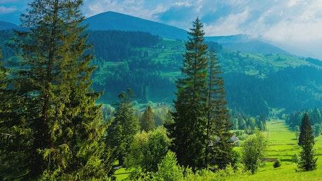 Time-lapse pan shot of a mountainous valley