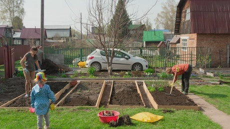 Timelapse of a family working on the garden