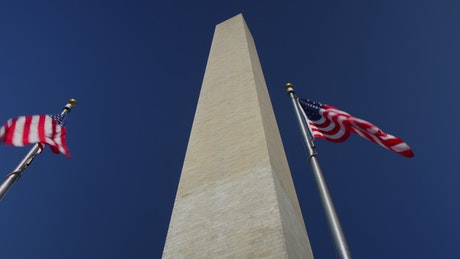 Timelapse of flags below the Washington Monument
