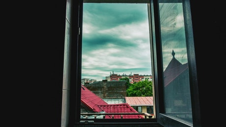 Timelapse of swirling clouds through a window