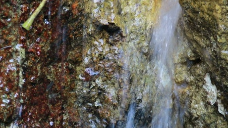 Tiny waterfall in a cracked rock