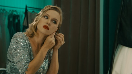 Tired and sad actress looking into the mirror