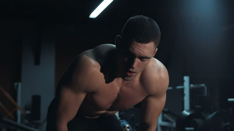 Tired athlete in a dark gym