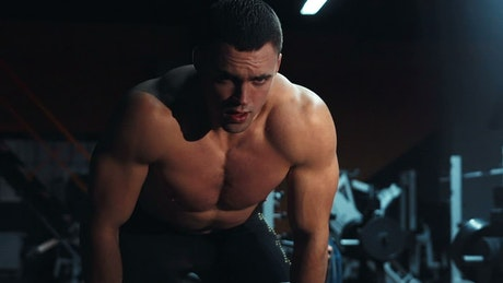 Tired bodybuilder in the gym