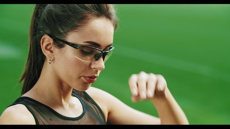 Tired runner wipes brow on green background