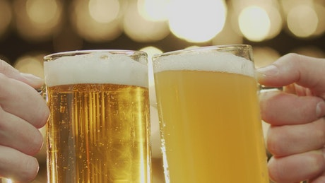 Toasting with two craft beers