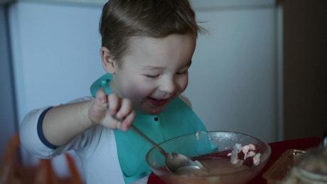 Toddler eating soup