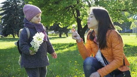 Toddler holding flowers