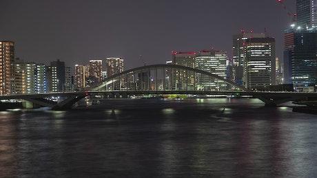 Tokyo bridge and water transport at night