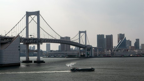 Tokyo bridge with traffic and river time lapse