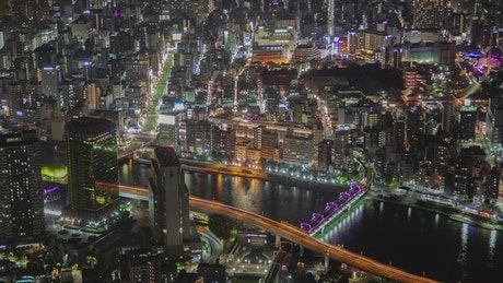 Tokyo iluminated cityscape and river at night