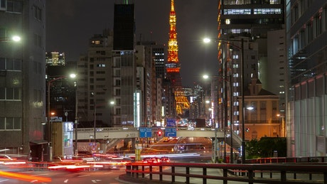 Tokyo Night street with fast traffic and tower
