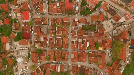 Top aerial shot from afar of a little town