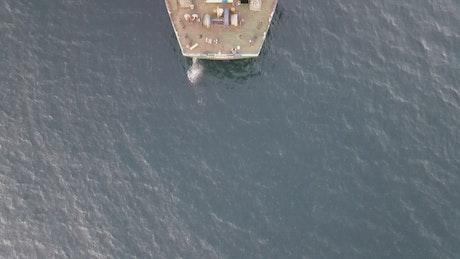 Top aerial shot of a cargo ship anchored