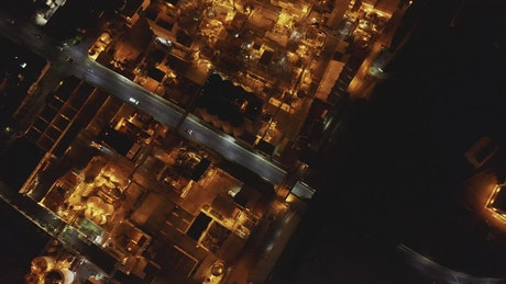 Top aerial view of a factory during night time