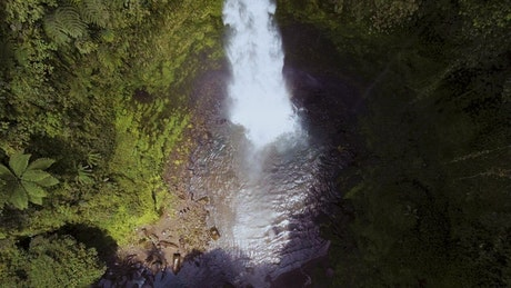Top afar shot of a waterfall in the forest