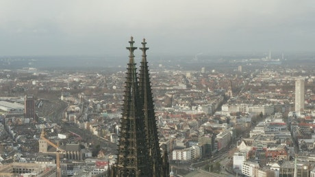 Top of a cathedral with the city in the background