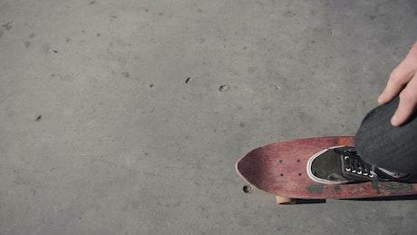 Top POV of a boy riding skateboard