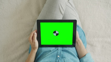 Top shot of a person using a tablet with chroma key