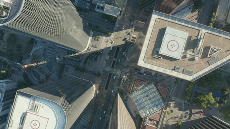Top spinning aerial shot of a city buildings