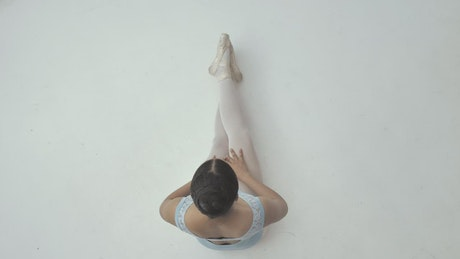 Top view of a ballerina while stretching