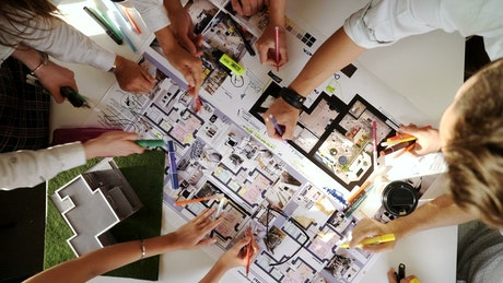 Top view of creative architects working on a project