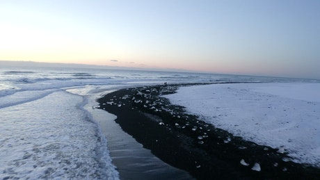 Tour on the seashore of a snowy winter beach