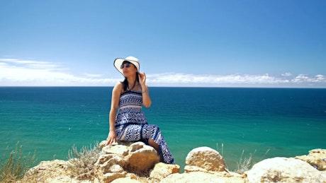 Tourist posing on the seashore