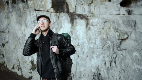 Tourist taking a call on a cave