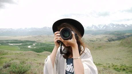 Tourist taking photos in nature