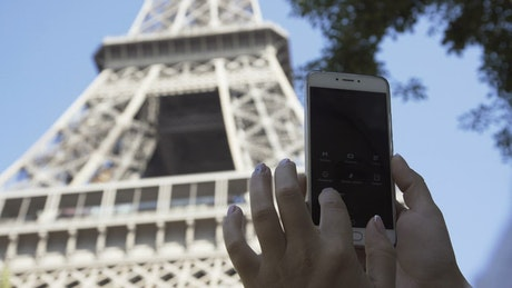 Tourist taking picture of the Eiffel tower