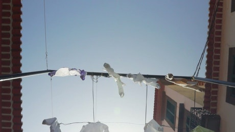 Tourist town street with shirts hung as decorations