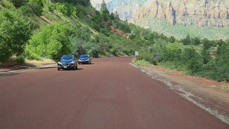 Tourists driving through a National Park