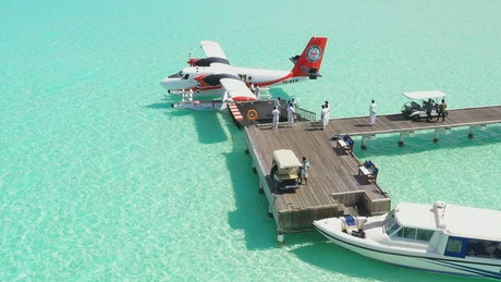 Tourists getting off a water plane on a pier
