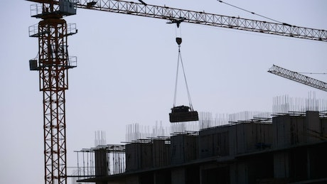 Tower crane silhouette on a construction site