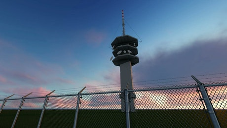 Tower with antennas in a fenced field, 3D render